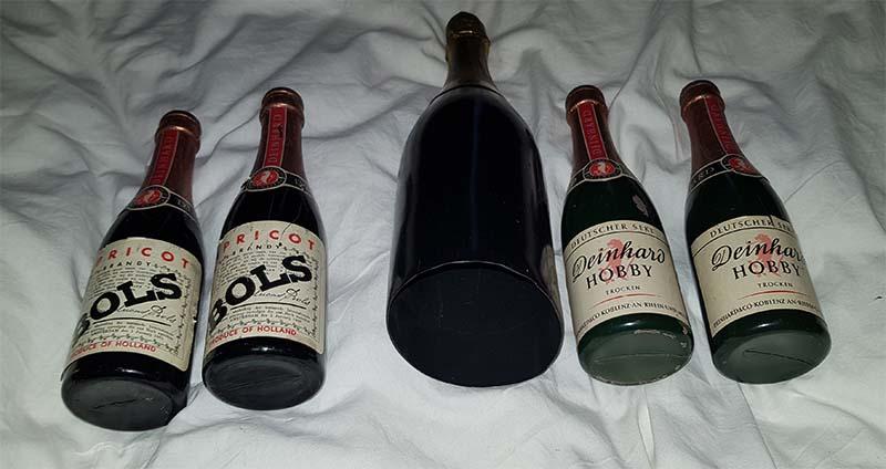 5 flessen